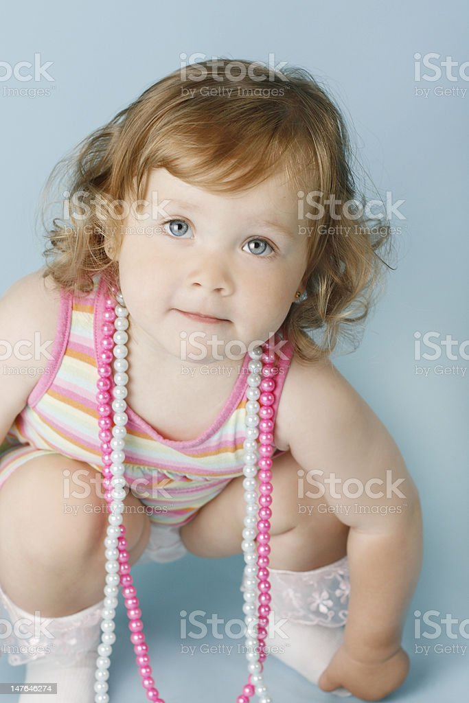 Baby girl in striped dress royalty-free stock photo