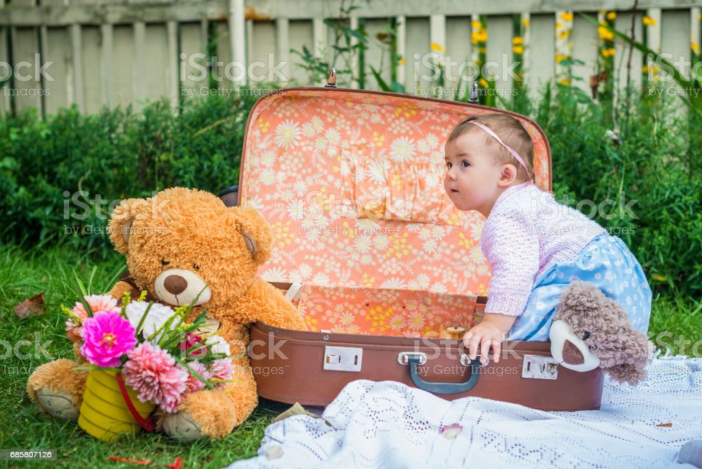 Baby girl in suitcase stock photo