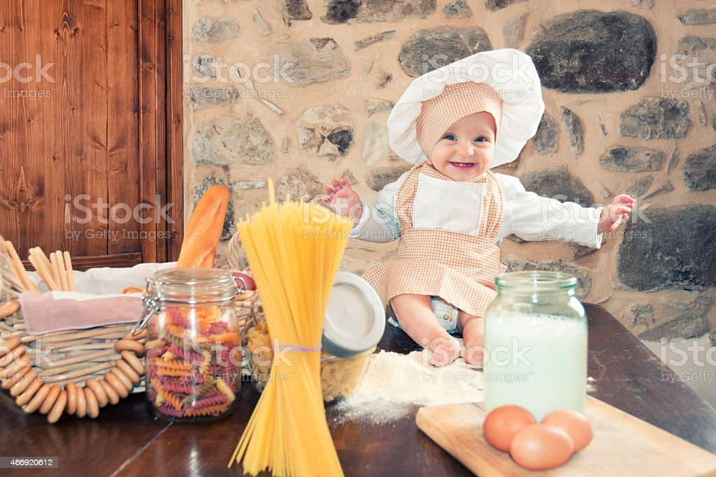 Baby girl in the kitchen stock photo
