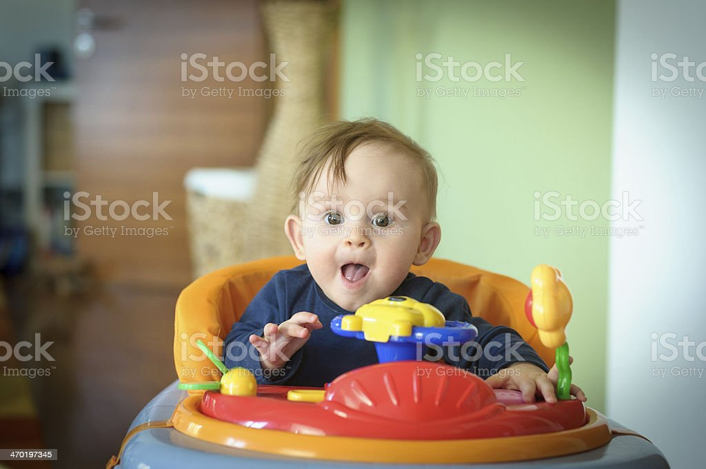 Baby Girl in Walker stock photo