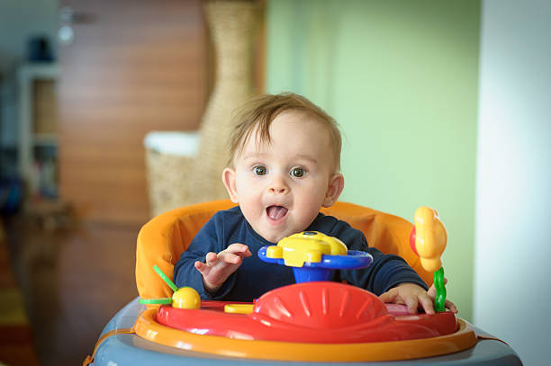 Baby Girl in Walker stock photo