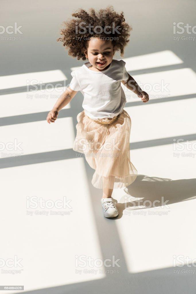 baby girl in white studio stock photo