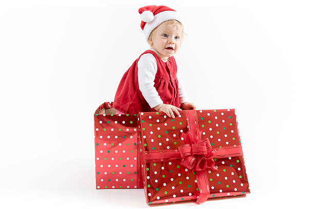 Baby Girl inside Christmas Gift Box stock photo