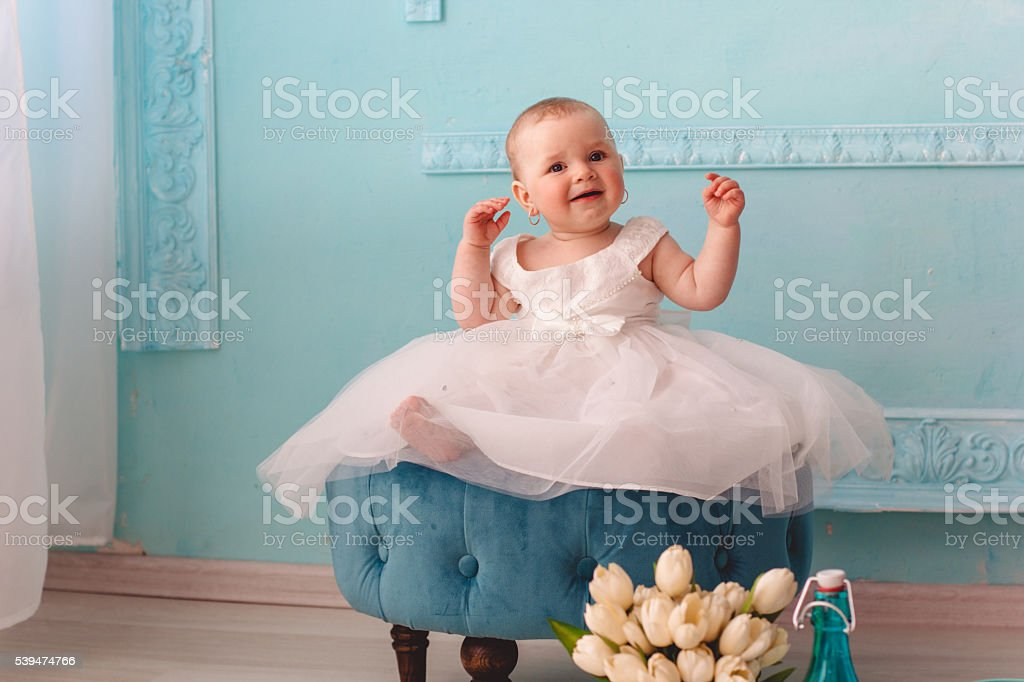Baby girl is wearing fashion bridal dress stock photo