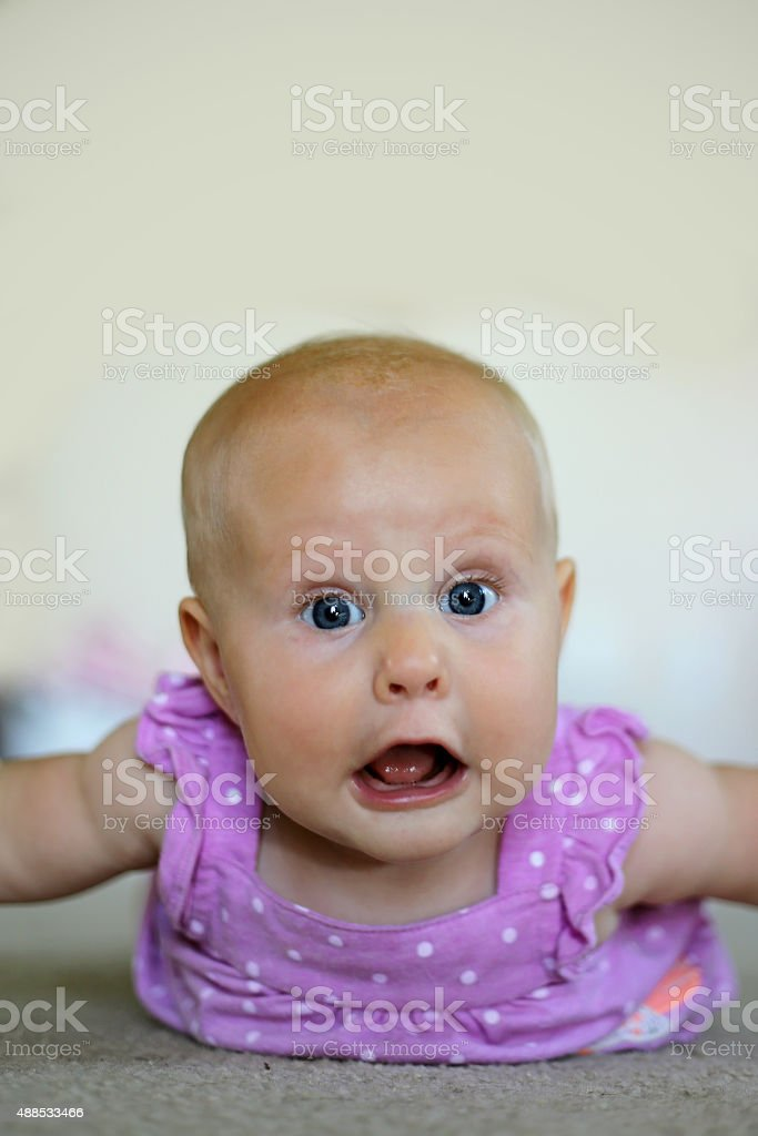 Baby Girl Making Funny Face stock photo