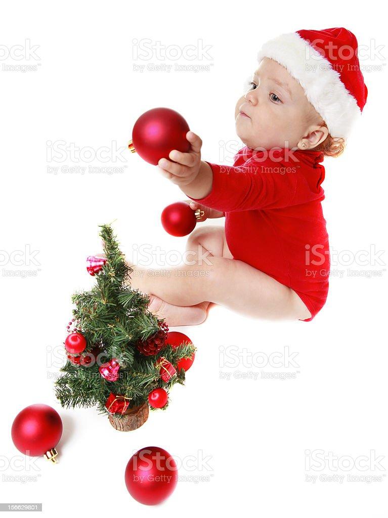 Baby girl  near the Christmas Tree royalty-free stock photo