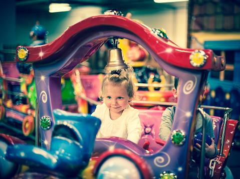 istock Baby girl on a choo-choo ride 486549393