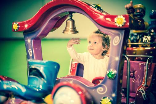 istock Baby girl on a choo-choo ride 487749911