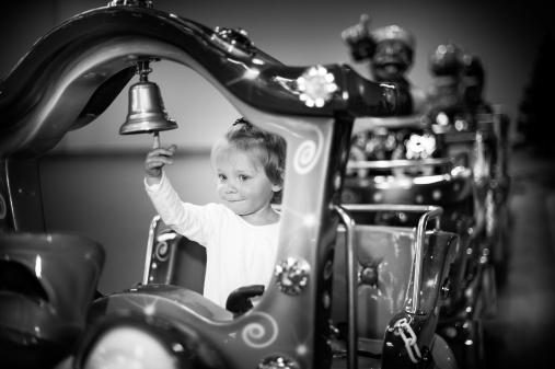 istock Baby girl on a choo-choo ride 487774611