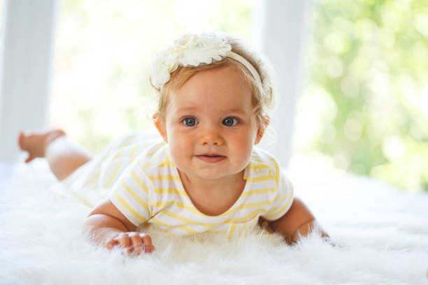 Baby girl on a fluffy blanket stock photo