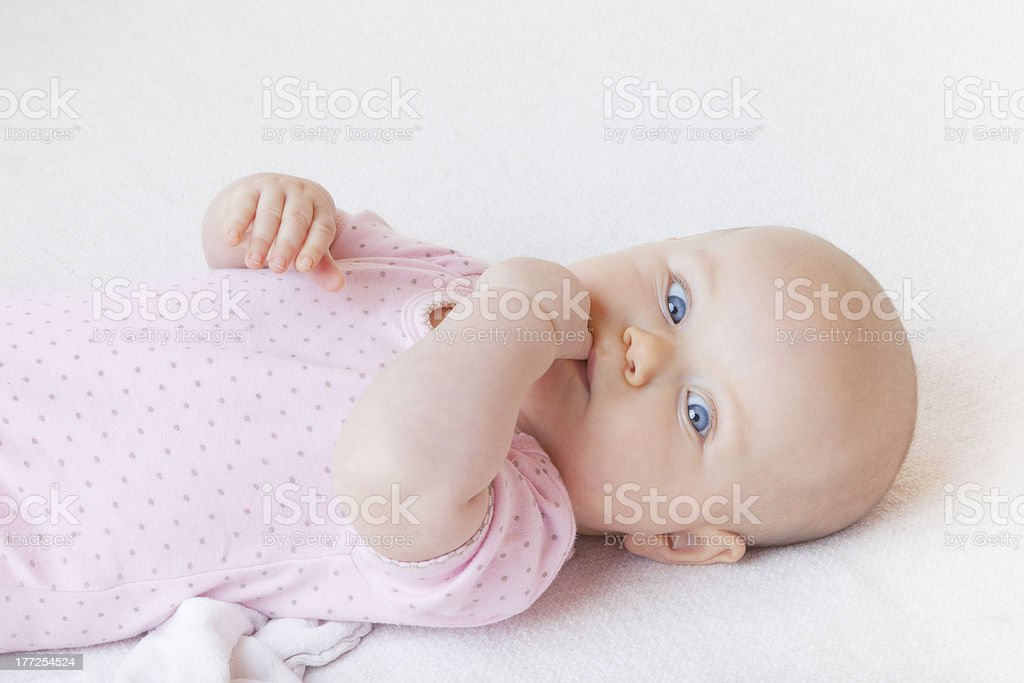 baby girl on bed royalty-free stock photo