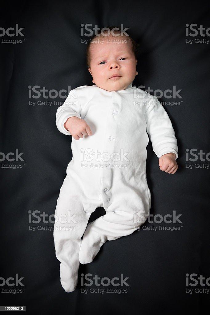 Baby girl on black background stock photo
