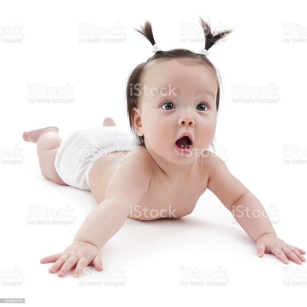 Baby girl on her stomach stock photo