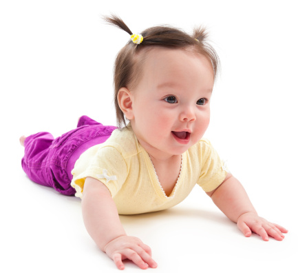 istock Baby girl on her stomach 153707424