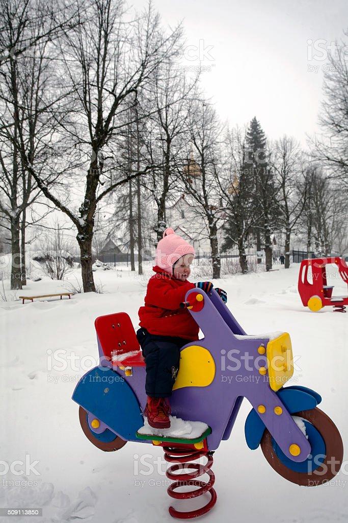 Baby Girl on the Playground stock photo