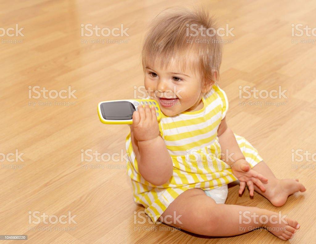 Baby Girl Phone Yellow Dress Cute 7 Stock Photo Download Image Now Istock