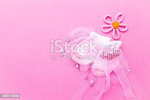 istock Baby Girl - pink and white socks with flower on pink background 693416536