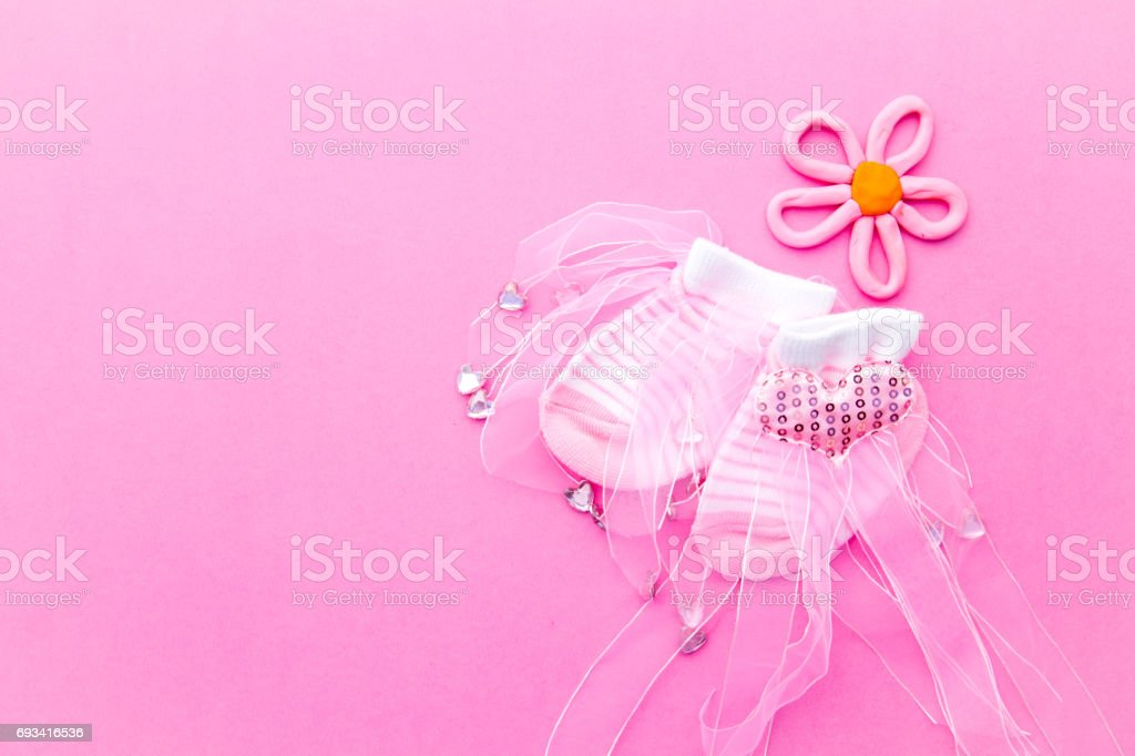 Baby Girl - pink and white socks with flower on pink background stock photo