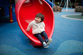 Baby girl play at outdoor playground