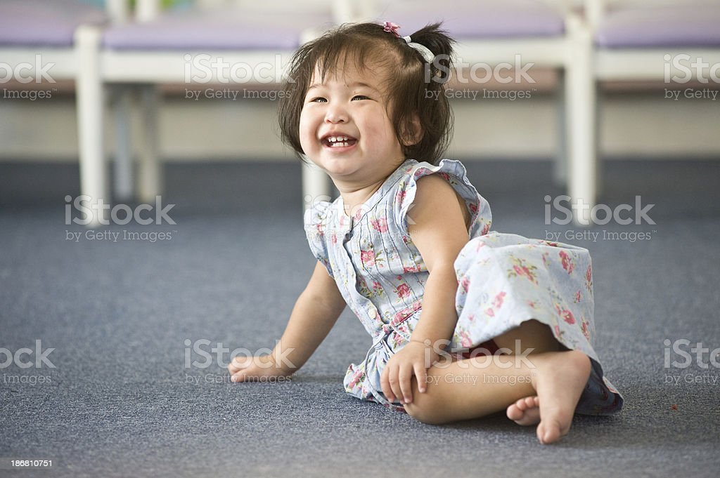 baby girl playing in a nursery. royalty-free stock photo