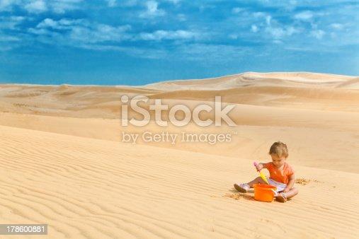 istock Baby girl playing in desert like big sandbox 178600881