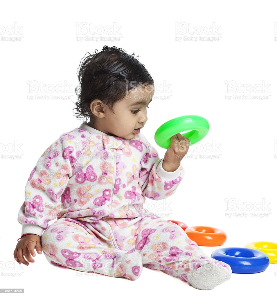 Baby Girl Playing with Colorful Rings, Isolated, White stock photo