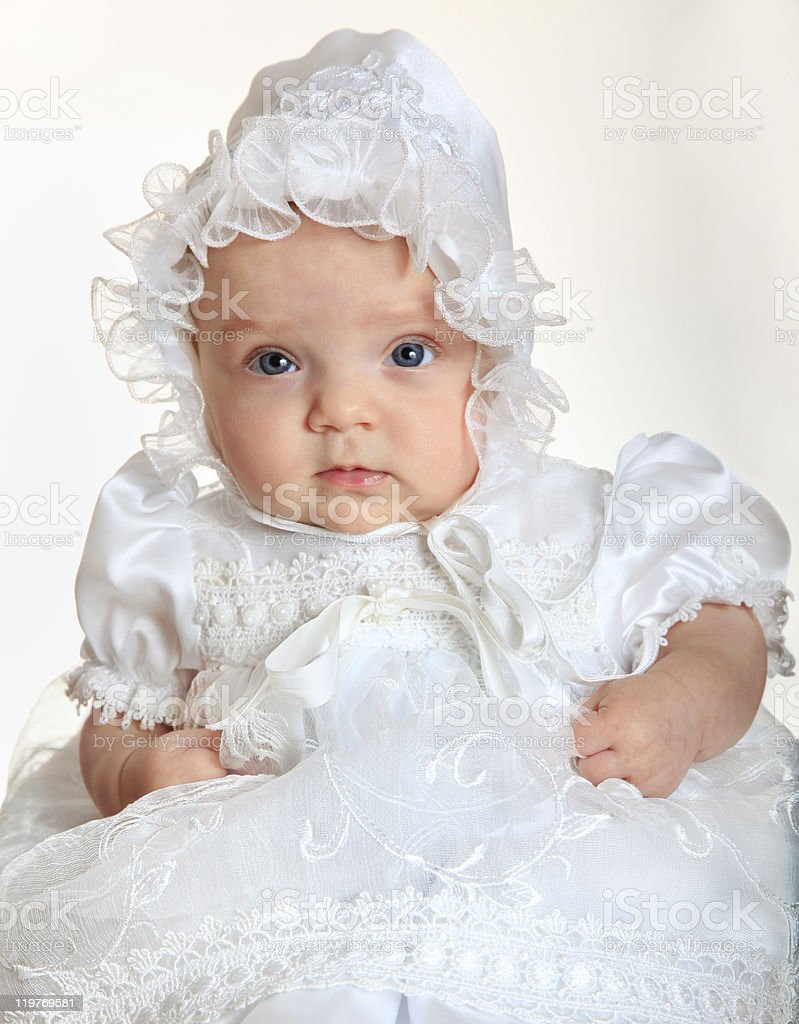 Baby girl portrait wearing an elegant white suit stock photo