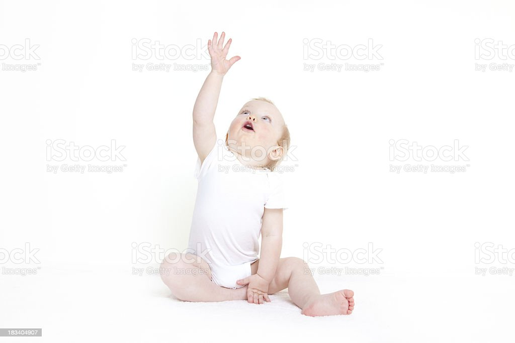 Baby girl reaching to the sky stock photo