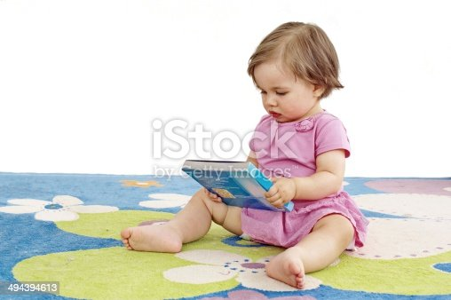 istock Baby Girl Reads 494394613