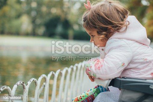 678589610istockphoto Baby girl relaxing in park 1067888958