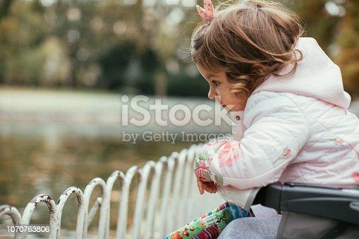 678589610istockphoto Baby girl relaxing in park 1070763806