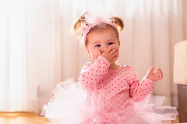 Baby girl sending kisses stock photo