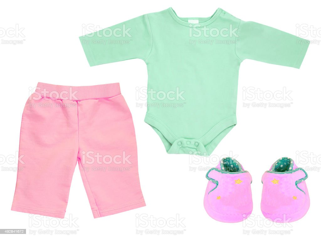Baby girl set of clothes isolated on white. stock photo