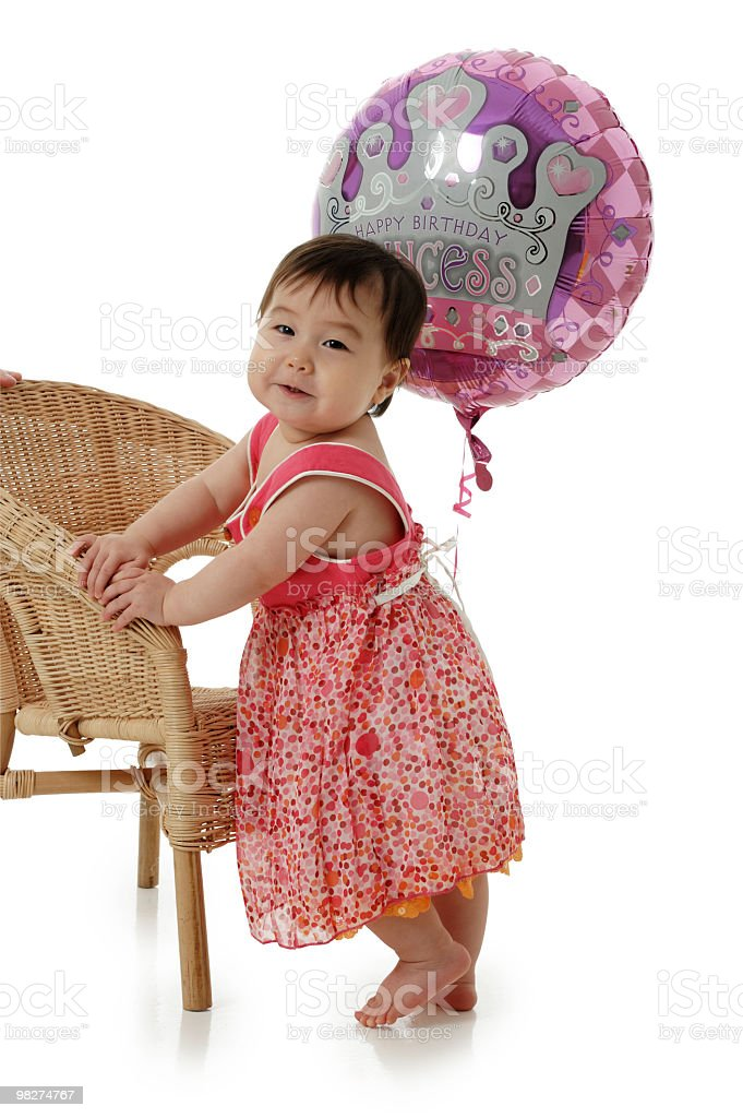 Baby Girl sit on cane chair royalty-free stock photo