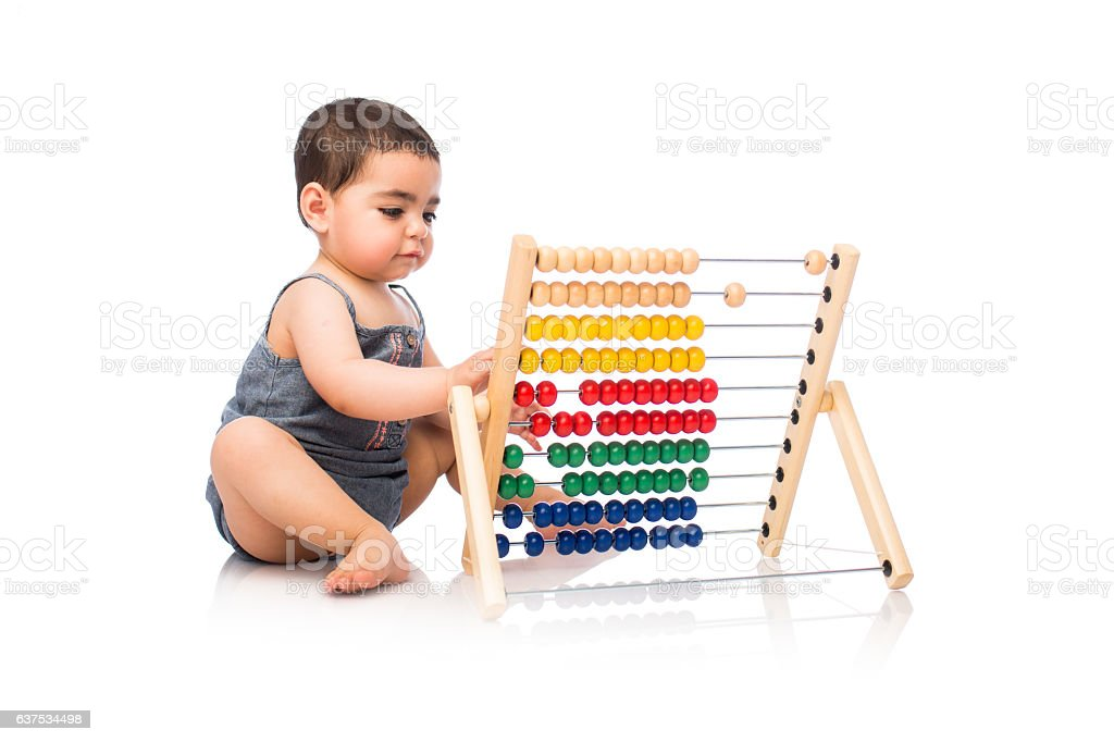 Baby girl sitting and playing with abacus - foto de stock