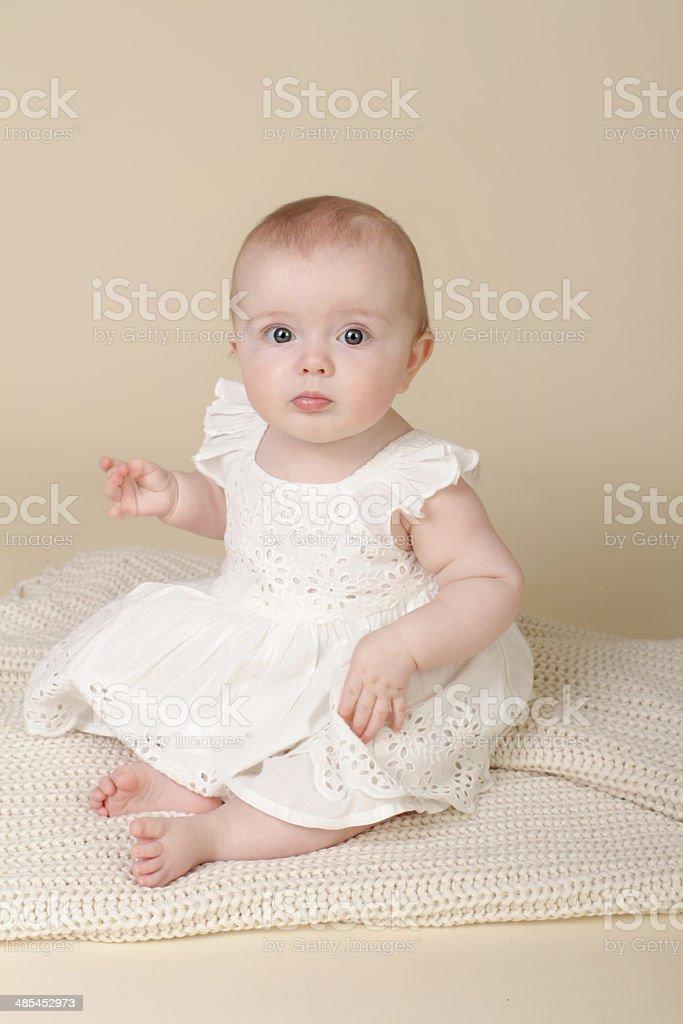 Baby Girl Sitting Up stock photo