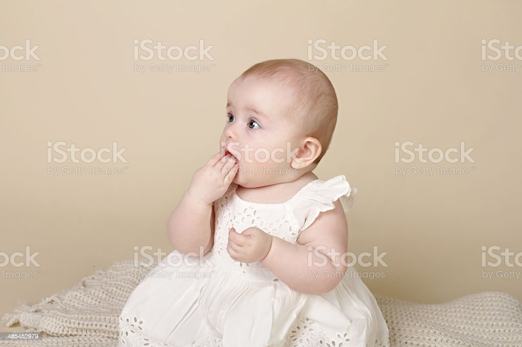 Baby Girl Sitting Up Teething royalty-free stock photo