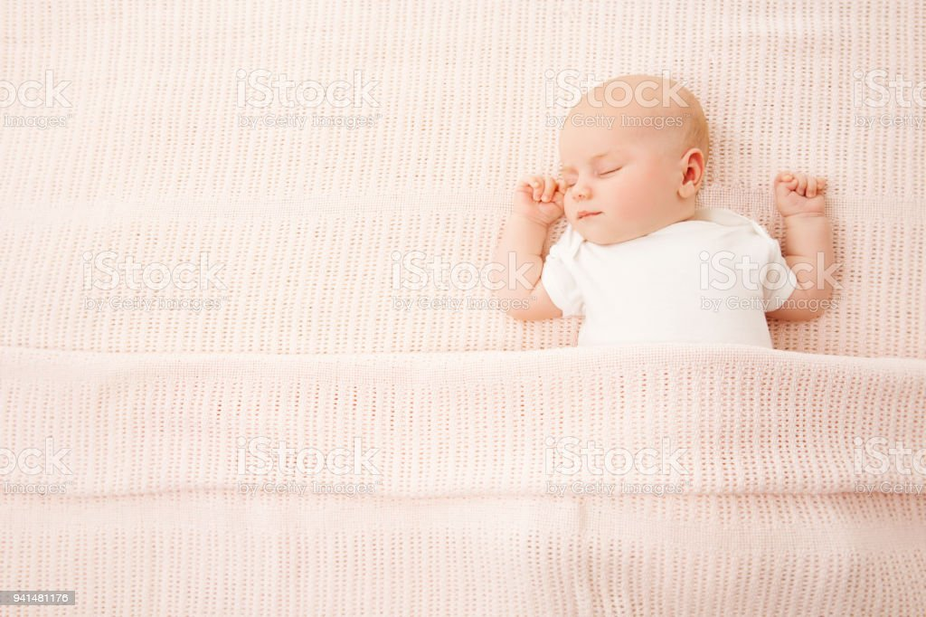 Baby Girl Sleep in Bed, Newborn Child Covered By Pink Knitted Blanket, Sleeping Kid stock photo