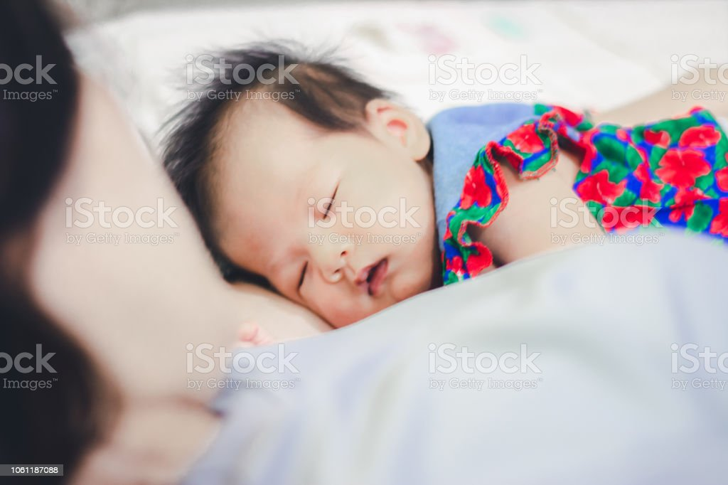 Baby Girl sleep with Aunty at home stock photo