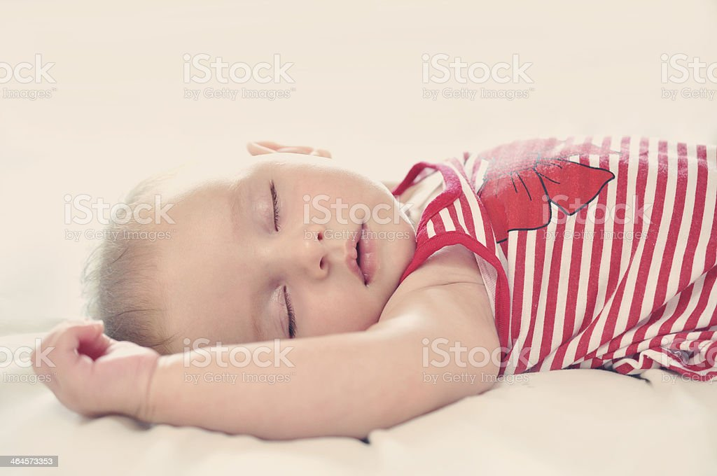 Baby Girl Sleepping On A Bed royalty-free stock photo
