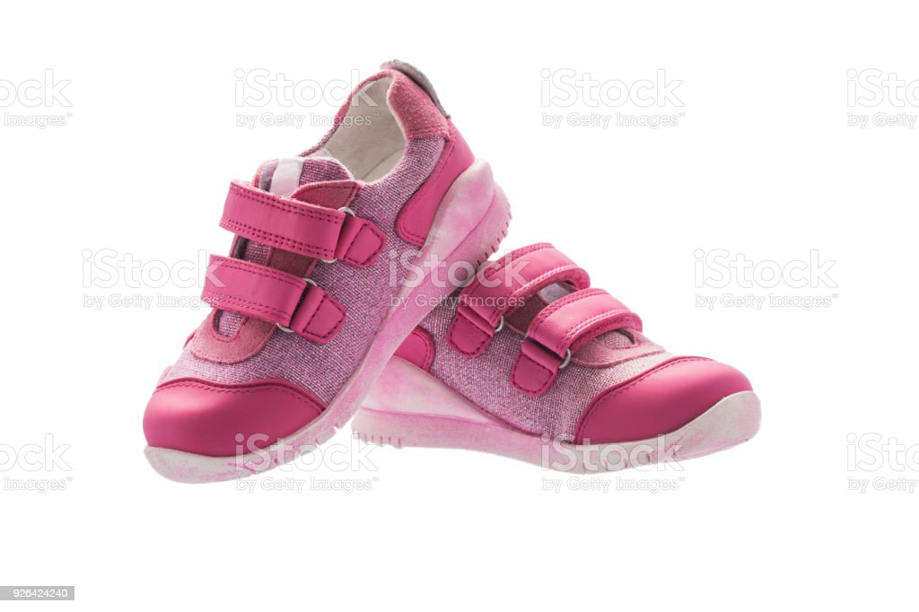 Baby girl small pink sport shoes isolated on white background stock photo