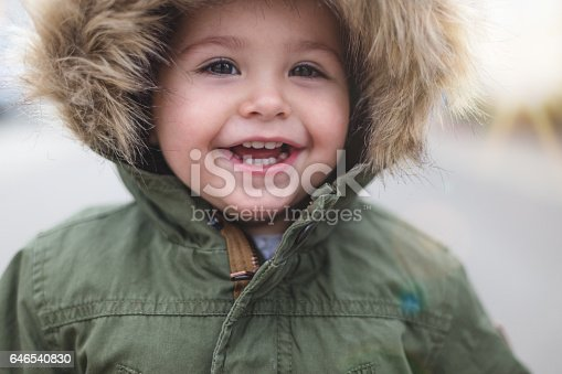 149051793 istock photo Baby girl smiling close up 646540830