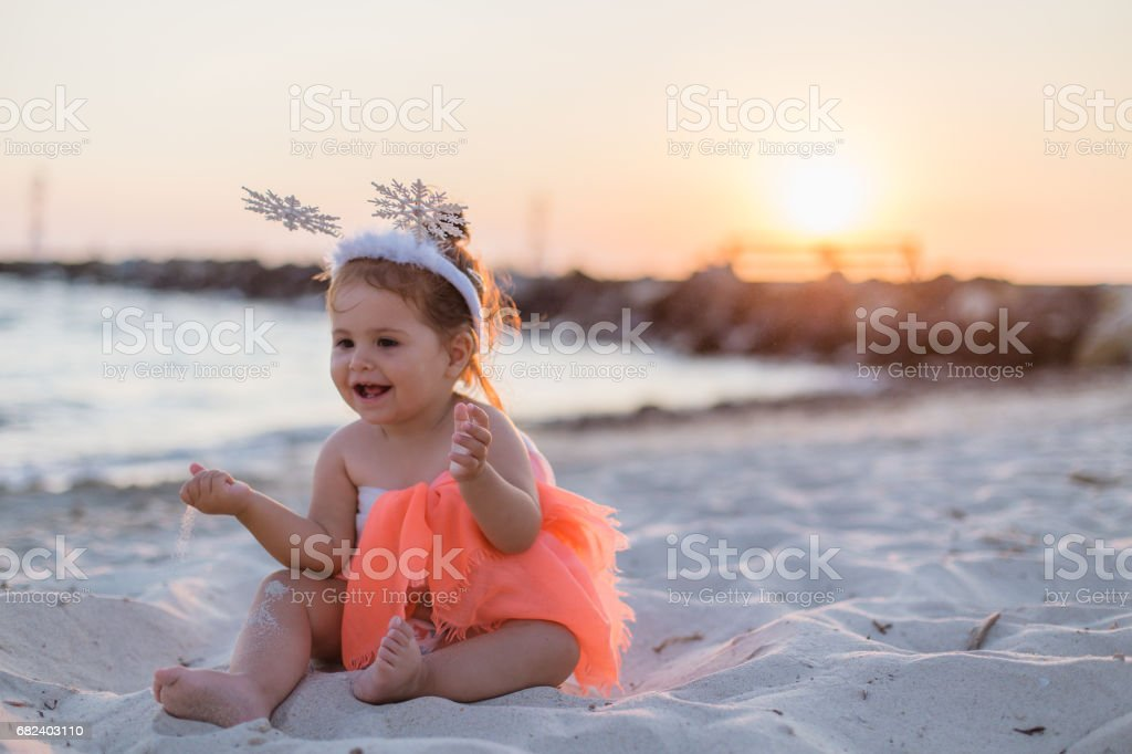 Baby girl smiling on the beach royalty-free stock photo