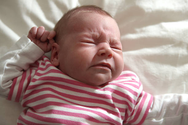Baby Girl Sneezing stock photo
