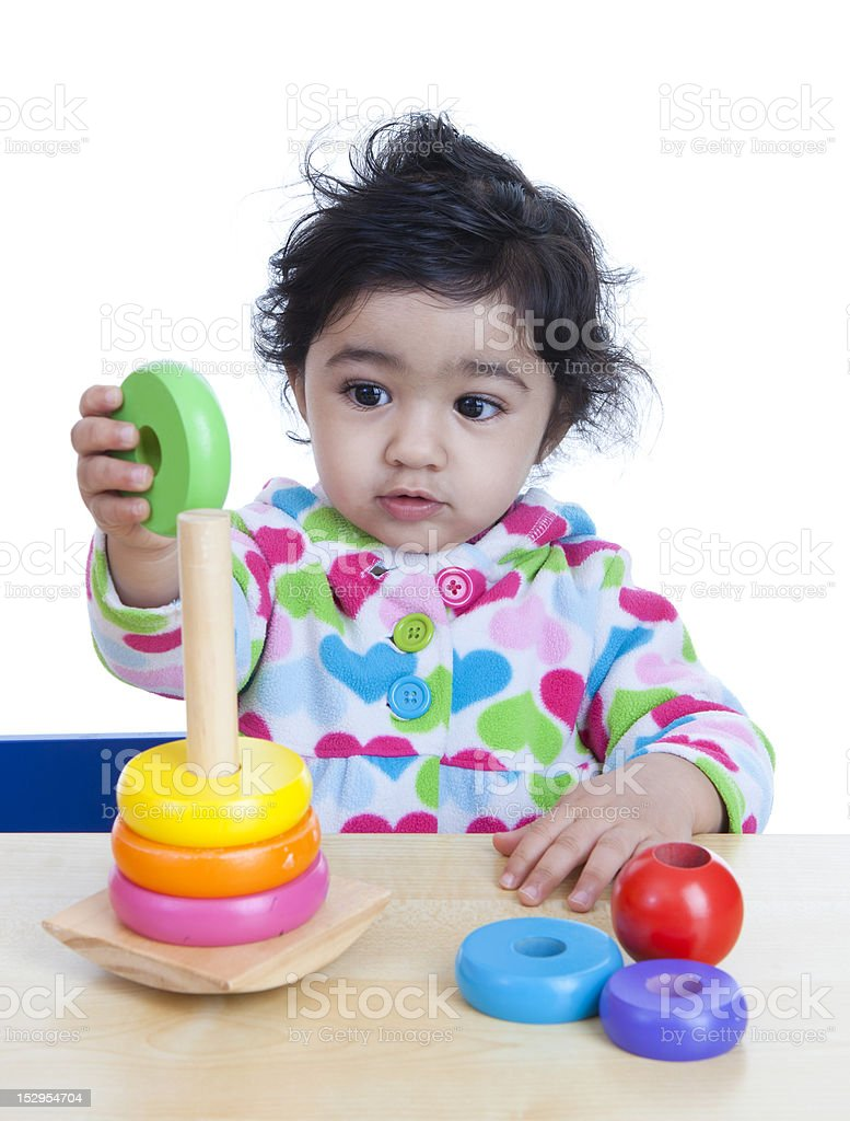 Baby Girl Stacking Colorful Rings stock photo