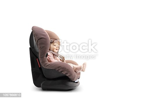 Baby girl strapped in a car seat isolated on white background