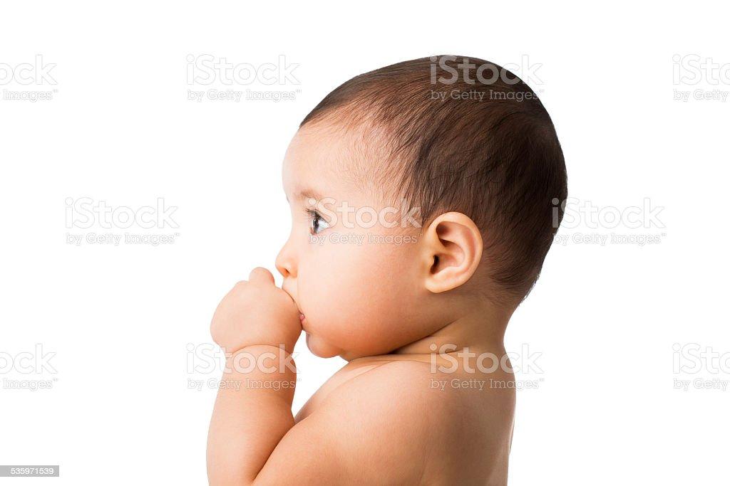 Baby girl sucking her thumb stock photo
