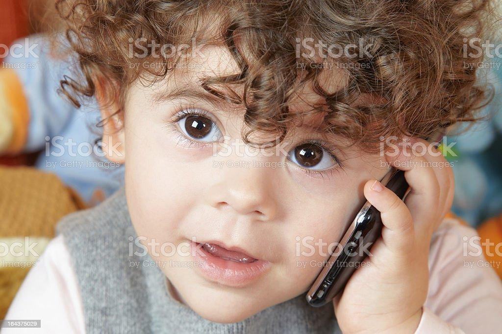 Baby girl talking on phone royalty-free stock photo