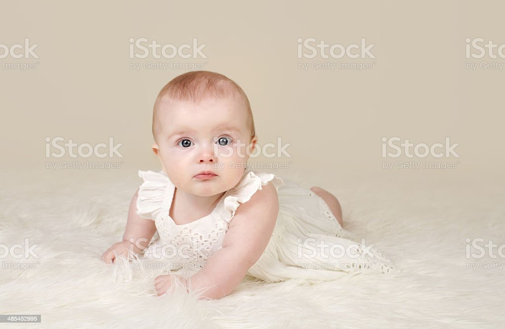 Baby Girl Tummy Time Smiling stock photo