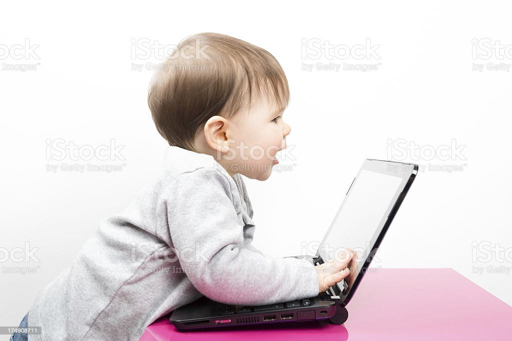 Baby girl using a laptop computer for video conferencing royalty-free stock photo